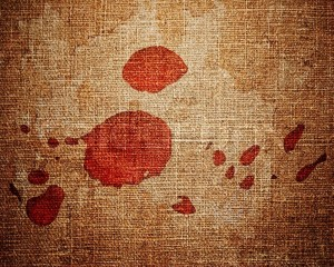1744252-close-up-of-red-paint-drops-on-canvas-background